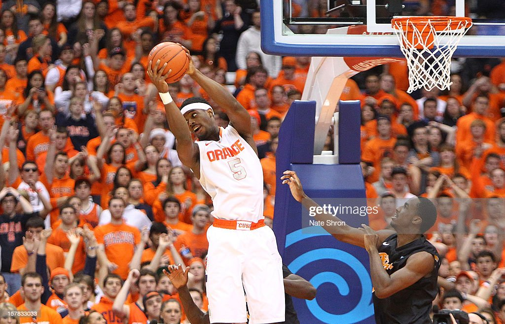 C.J. Fair #5 of the Syracuse Orange catches a pass while being guarded by Nick Shepherd #33 of the Long Beach State 49ers during the game at the Carrier Dome on December 6, 2012 in Syracuse, New York.