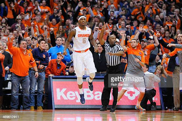 J Fair of the Syracuse Orange celebrates his gamewinning basket against the North Carolina State Wolfpack during the second half at the Carrier Dome...