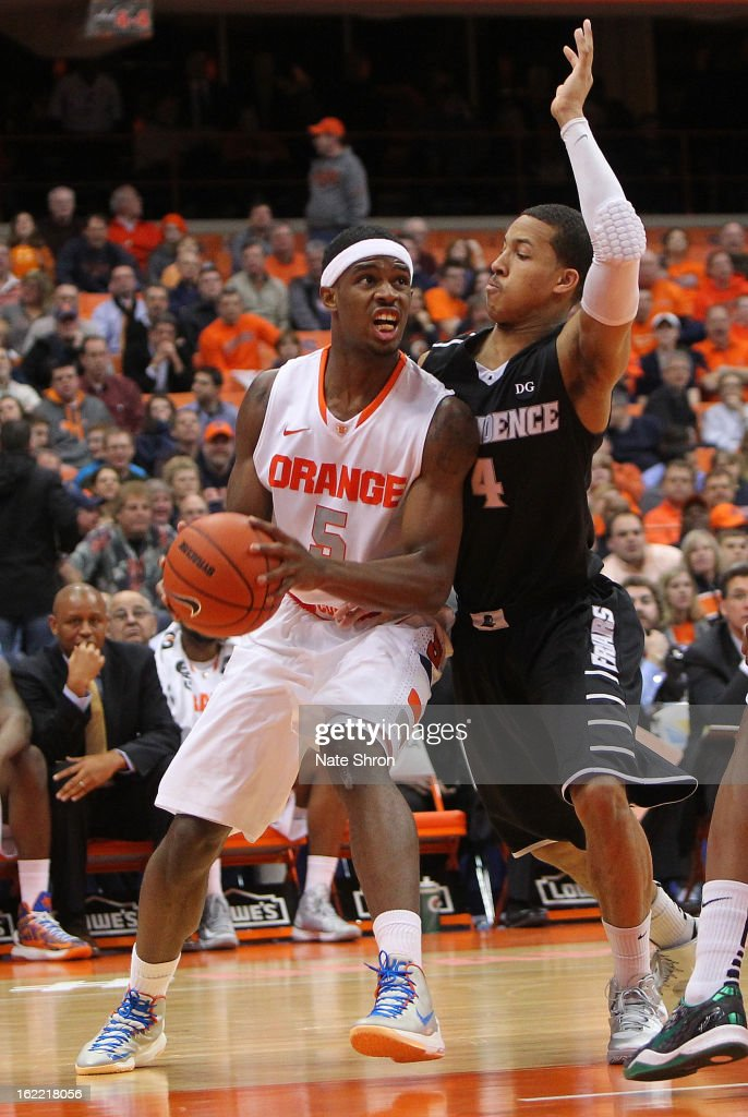 C.J. Fair #5 of the Syracuse Orange drives to the basket against Josh Fortune #4 of the Providence Friars during the game at the Carrier Dome on February 20, 2013 in Syracuse, New York.