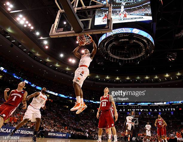 J Fair of the Syracuse Orange goes up to dunk the ball against Josh Gasser of the Wisconsin Badgers during their 2012 NCAA Men's Basketball East...