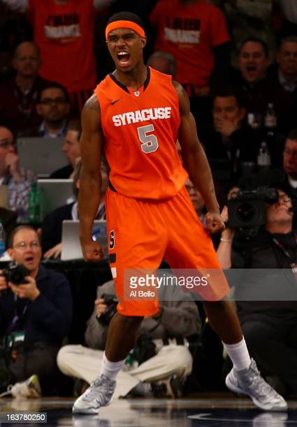 Fair of the Syracuse Orange reacts after he dunked the ball against the Georgetown Hoyas during the semifinals of the Big East Men's Basketball...