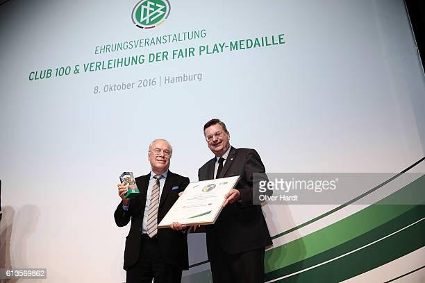 Fair Play medal winner Bernard Desumer poses with DFB President Reinhard Grindel during Club 100 Fair Ist Mehr Awarding Ceremony at Curio Haus on...