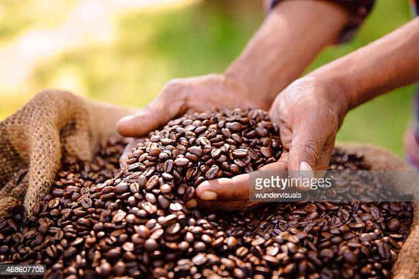 fair trade farming is best for coffee bean produce - coffee stock photos and pictures