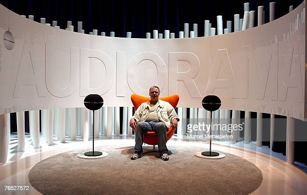 A fair visitor listens to a surround sound system by Grundig at the IFA trade fair during the fair's last day at ICC exhibition center September 05...