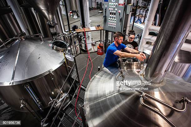 Fair Winds Brewmaster Charlie Buettner and brewer Jill Yoffe clean a tank Heritage Brewing Co and Fair Winds Brewing Company are Virginia breweries...
