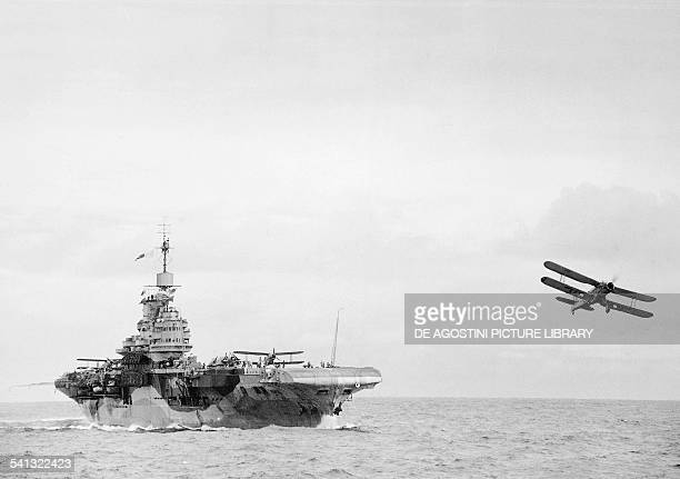 Fairey Albacore biplane torpedo bombers taking off from the British aircraft carrier HMS Illustrious Second World War United Kingdom 20th century...