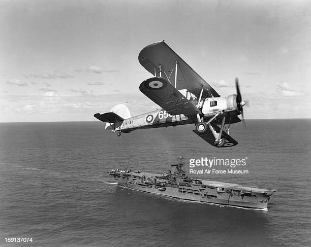 Fairey Swordfish I of 820 Squadron over HMS Ark Royal 1939