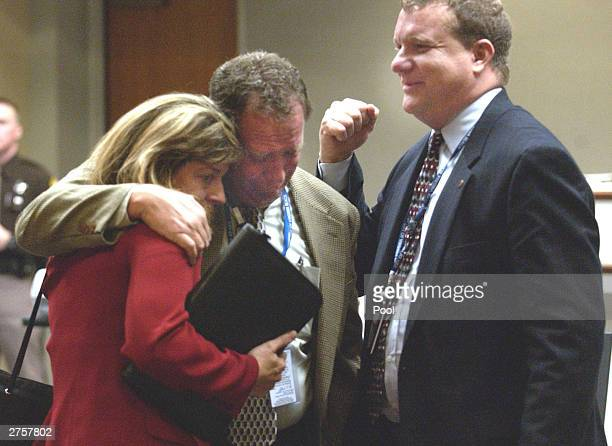 Fairfax County Sniper Task Force supervisor, Lt. Bruce Guth , is comforted by Melissa Thomas and FBI special agent Mike McCoy after the sentence of...