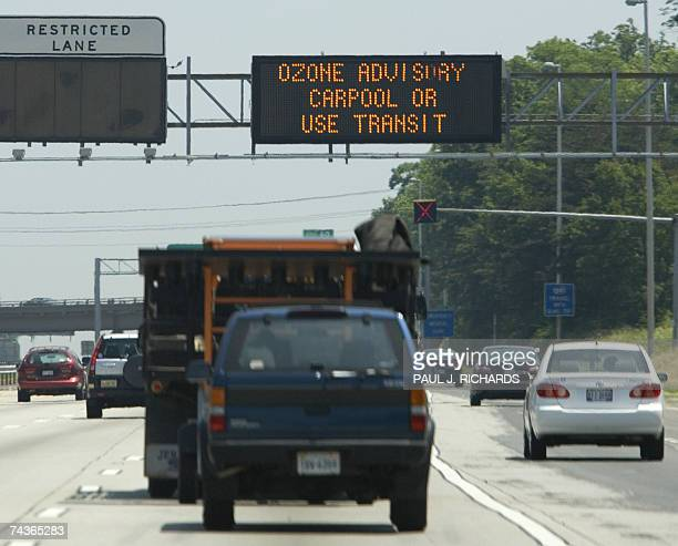 Commuters on Interstate 66 in Fairfax Virginia drive 31 May 2007 under a Ozone alert Fairfax Virginia is about 22 miles outside Washington DC...