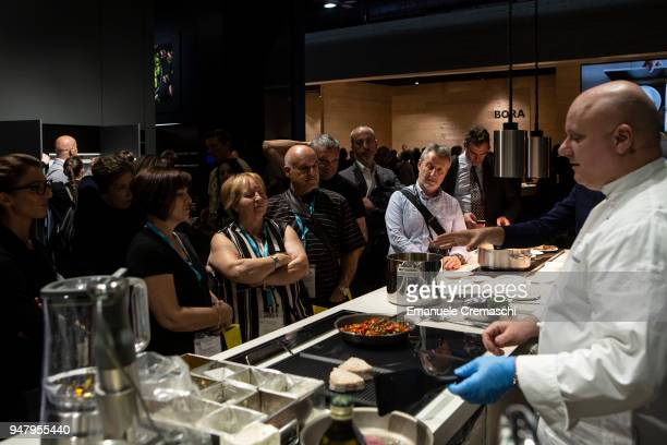 Fairgoers attend a cooking show at the Electrolux display stand during the Salone Internazionale del Mobile at Fiera di Rho on April 17 2018 in Milan...