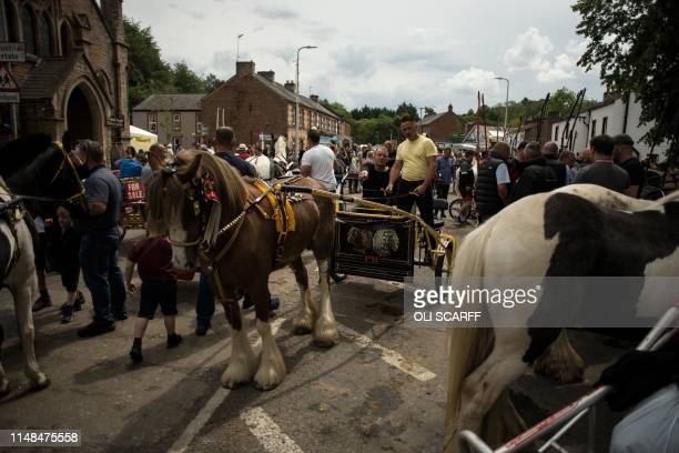 Fairgoers attend on the second day of the annual Appleby Horse Fair, in the town of Appleby-in-Westmorland, north west England on June 7, 2019. - The...