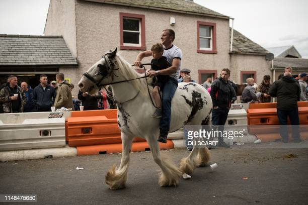 Fairgoers attend the second day of the annual Appleby Horse Fair, in the town of Appleby-in-Westmorland, north west England on June 7, 2019. - The...