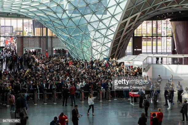 Fairgoers queue in front one of the gates during the Salone Internazionale del Mobile at Fiera di Rho on April 17 2018 in Milan Italy Every year...