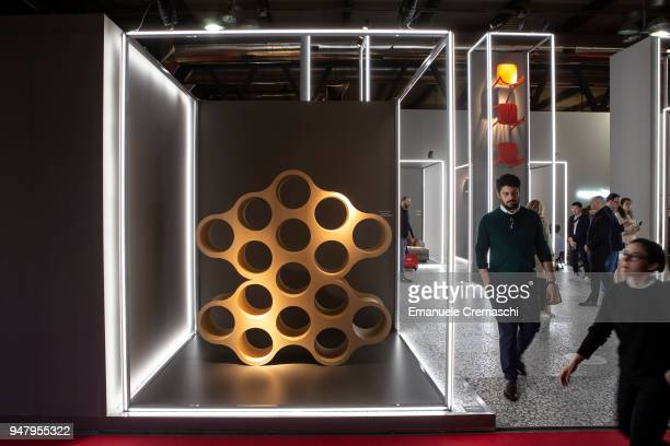 Fairgoers visit the Cappellini display stand during the Salone Internazionale del Mobile at Fiera di Rho on April 17 2018 in Milan Italy Every year...