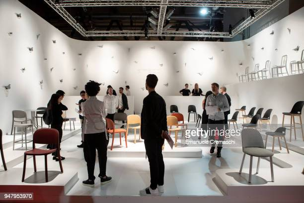 Fairgoers visit the Emeco display stand during the Salone Internazionale del Mobile at Fiera di Rho on April 17 2018 in Milan Italy Every year Salone...