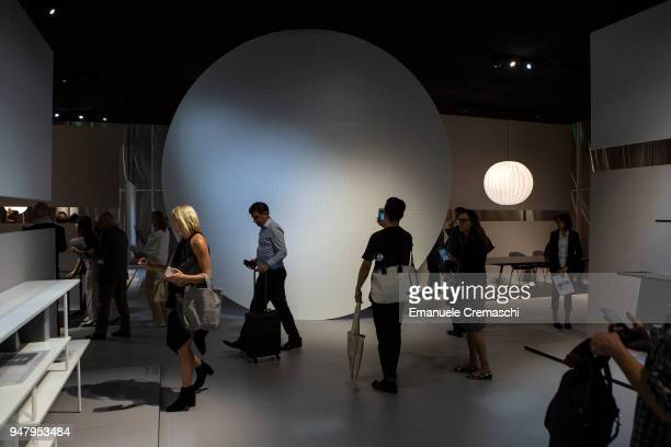 Fairgoers visit the MDF Italia display stand during the Salone Internazionale del Mobile at Fiera di Rho on April 17 2018 in Milan Italy Every year...