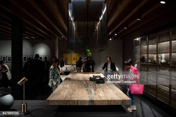 Fairgoers visit the Molteni C display stand during the Salone Internazionale del Mobile at Fiera di Rho on April 17 2018 in Milan Italy Every year...
