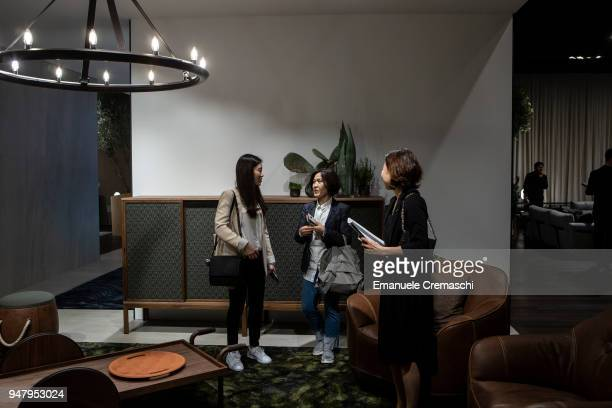Fairgoers visit the Natuzzi display stand during the Salone Internazionale del Mobile at Fiera di Rho on April 17 2018 in Milan Italy Every year...