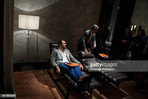 Fairgoers visit the Poltrona Frau display stand during the Salone Internazionale del Mobile at Fiera di Rho on April 17 2018 in Milan Italy Every...