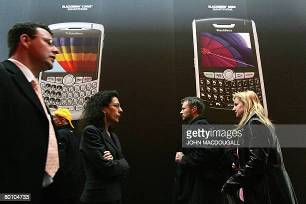 Fairgoers walk past the Blackberry stand at the CeBIT trade fair in Hanover on March 4, 2008. The world's biggest high-tech fair runs from March 04...