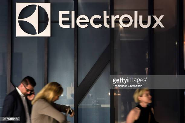 Fairgoers walk past the Electrolux display stand during the Salone Internazionale del Mobile at Fiera di Rho on April 17 2018 in Milan Italy Every...