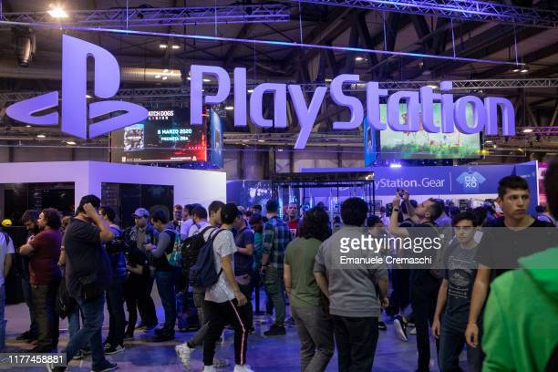 Fairgoers walk past the logo of Japanese publisher Sony Computer Entertainment's PlayStation stand during the Milan Games Week 2019, on September 27,...