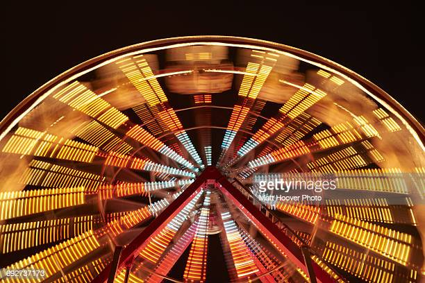 fairground ride at night, long exposure - st. joseph missouri stock pictures, royalty-free photos & images