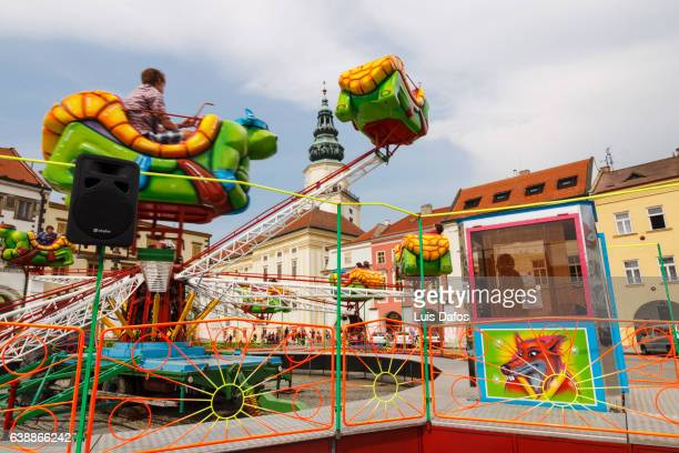 fairground ride at the main town square of kromeriz - dafos stock photos and pictures
