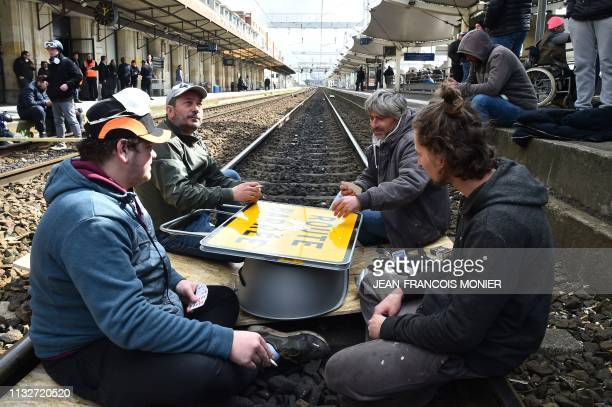 Fairground workers block the rail track of Le Mans railway station to demand a return of the fairground to the centre of the city in Le Mans on March...