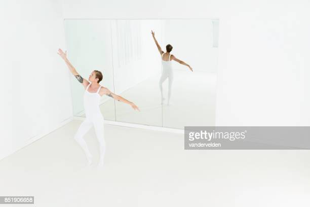 fair-haired male ballet dancer - full length mirror stock photos and pictures