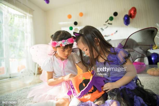 fairies and witches trade their sweets. at the halloween party. - naughty halloween stock photos and pictures