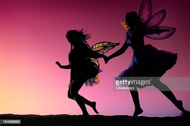 fairies dancing in the evening light - fairy stock pictures, royalty-free photos & images