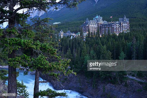 fairmont banff springs hotel with bow river - banff national park stock pictures, royalty-free photos & images