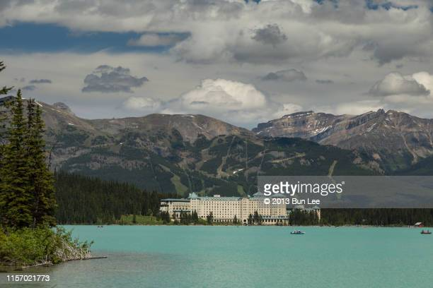fairmont chateau lake louise - chateau lake louise stock photos and pictures