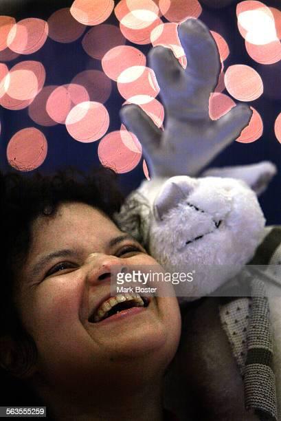 –Fairview Developmental Center client Juanita Rene Jones laughed at the fuzzy little white reindeer that Santa Claus gave her after Sunday Mass...