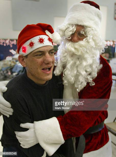 –Fairview Developmental Center client Mark Bivens got a special hug from Santa Claus after Sunday Mass Sunday Mass takes on a special meaning at the...