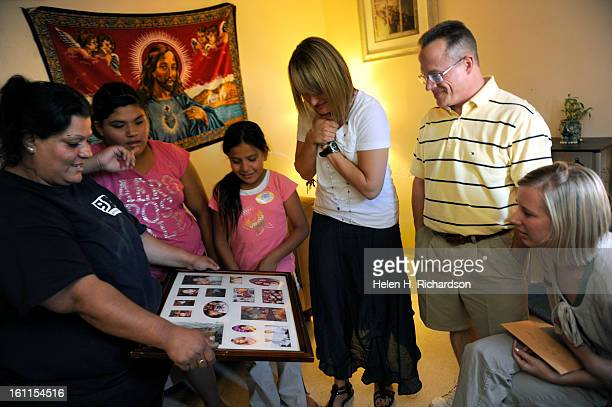 Fairview Elementary teachers from right to left Alex Stankovich Don Diehl and Kendra Rohnert look at the family photos of parent Erica Valdez left...