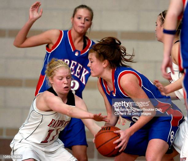 Fairview's Paige Narum tries to steal the ball from Cherry Creek's Allison Scholbe in front of Maggie Morton in the first half at Monarch High School...