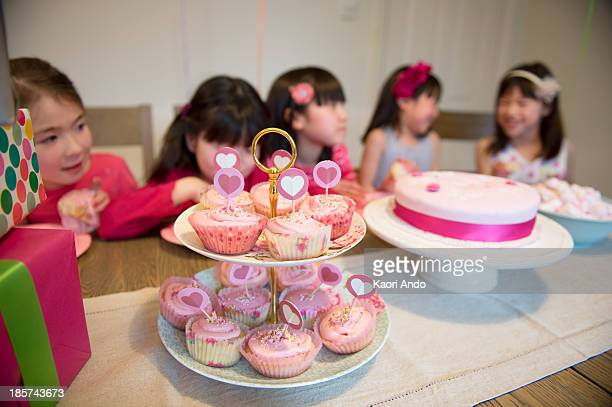 fairy cakes at girl's birthday party - cobham surrey stock pictures, royalty-free photos & images