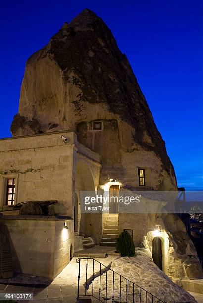 A fairy chimney with cave rooms at Cappadocia Cave Suites in Göreme in the region of Cappadocia in Turkey The touristy region of Cappadocia famous...
