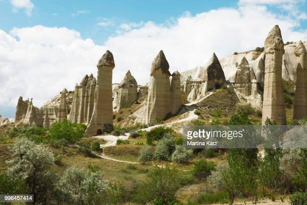 fairy chimneys, tufa formations in love valley, goreme national park, nevsehir province, cappadocia, anatolia, turkey - central anatolia stock photos and pictures