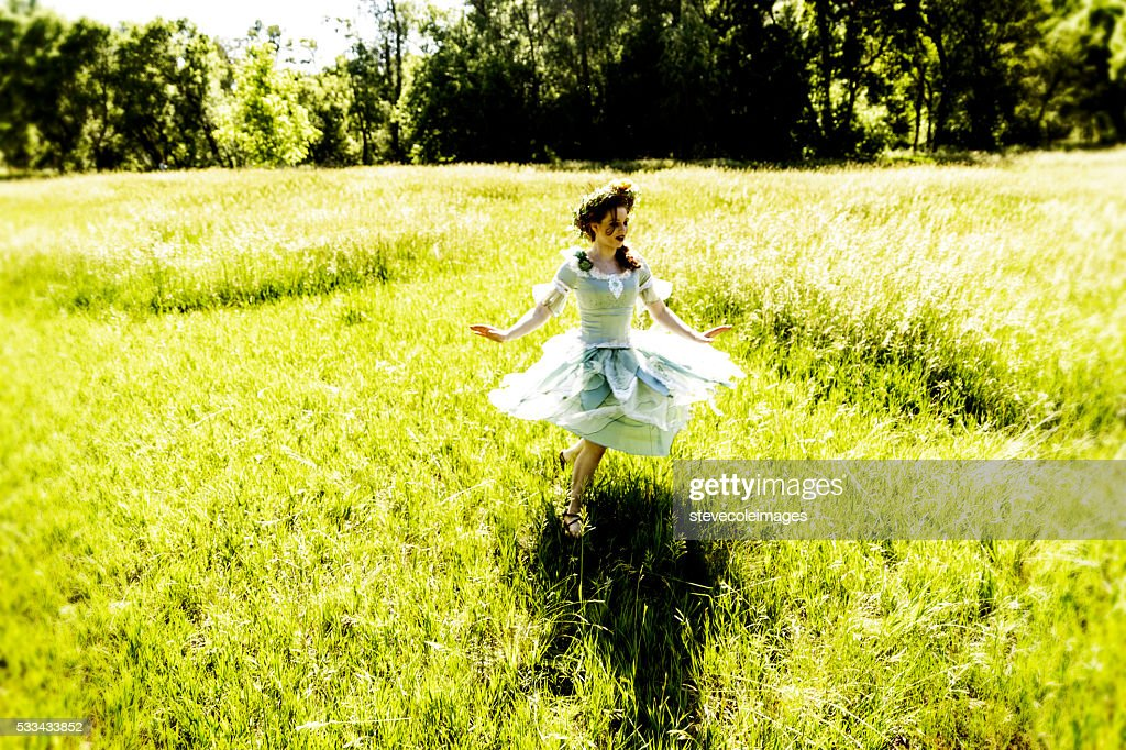 Fairy Dancing in Field : Stock Photo