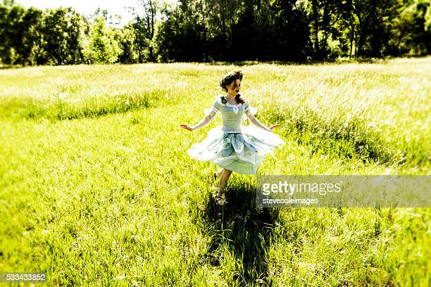 fairy dancing in field - image stockfoto's en -beelden