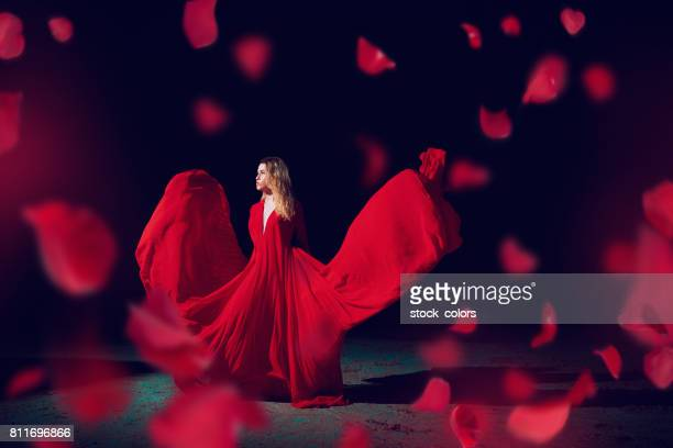 fairy in the night time - red dress stock photos and pictures