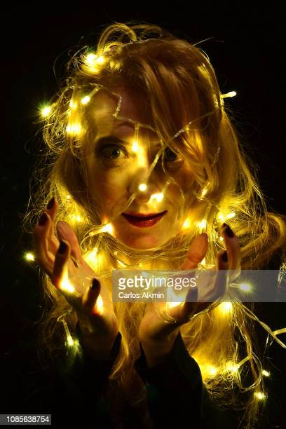 Fairy Lights around a beautiful blond woman