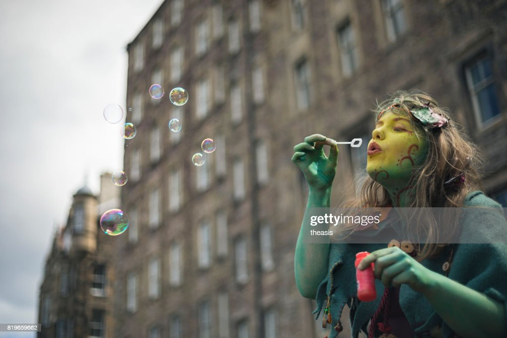 Fairy Performer Blowing Bubbles : Stock Photo