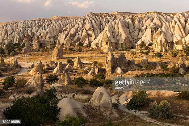 fairy tale landscape chimney rocks valley of cappadocia, turkey - cappadocia stock pictures, royalty-free photos & images