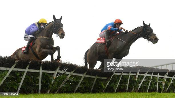 Fairyhouse Ireland 3 December 2017 Cilaos Emery with Patrick Mullins up left jump the last alongside Mick Jazz with Davy Russell up during the Bar...