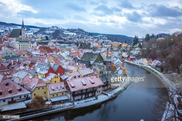 a fairytale small town covered by snow, český krumlov, czech republic - cesky krumlov castle stock photos and pictures