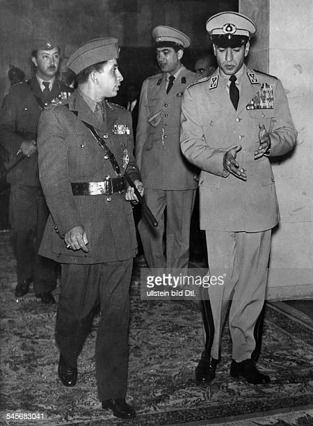 Faisal II *King of Iraq 193958during a visit in Iran with Shah Reza Pahlavi at the back Crown Prince AbdulIllah and Prince Gholam Reza